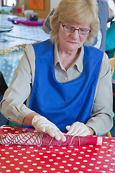 Felt making class for people with a visual impairment - rolling wool to make felt.