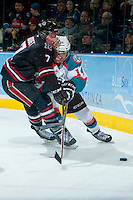 KELOWNA, CANADA -FEBRUARY 5: Brady Gaudet D #7 of the Red Deer Rebels checks Rourke Chartier #14 of the Kelowna Rockets behind the net during the second period on February 5, 2014 at Prospera Place in Kelowna, British Columbia, Canada.   (Photo by Marissa Baecker/Getty Images)  *** Local Caption *** Brady Gaudet; Rourke Chartier;