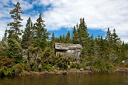 Abandoned wood shack on the shore of Bailey Island, Isle Royale National Park, Michigan, United States of America