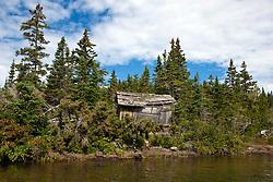 Abandoned wood shack on the shore of Bailey Island, Isle Royale National Park, Michigan, United States of America