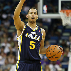 April 11, 2011; New Orleans, LA, USA; Utah Jazz point guard Devin Harris (5) against the New Orleans Hornets during the first half at the New Orleans Arena.  Mandatory Credit: Derick E. Hingle
