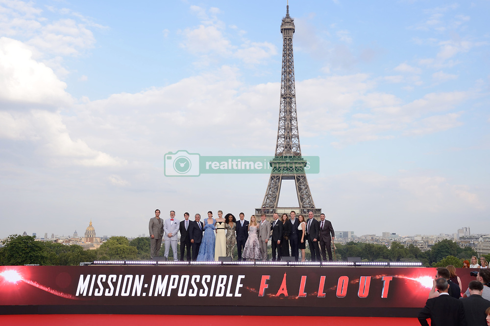 Henry Cavill, Jake Myers, Michelle Monaghan, Angela Bassett, Christopher McQuarrie, Tom Cruise, Simon Pegg, Vanessa Kirby, Rebecca Ferguson, Alix Benezech, Caspar Phillipson and producers pose in front of the Eiffel Tower during the Global Premiere of Mission: Impossible - Fallout at Palais de Chaillot in Paris, France on July 12, 2018. Photo by Aurore Marechal/ABACAPRESS.COM