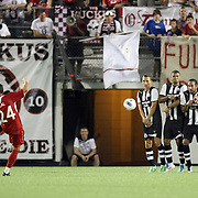 Orlando City Lions MIdfielder Lewis Neal (24) kicks a free kick during an International Friendly soccer match between English Premier League team Newcastle United and the Orlando City Lions of the United Soccer League, at the Florida Citrus Bowl on Saturday, July 23, 2011 in Orlando, Florida. Orlando won the match 1-0. (AP Photo/Alex Menendez)