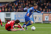 Dannie Bulman midfielder of AFC Wimbledon (4) escapes Crawley Town Midfielder Andy Bond (22) challenge during the Sky Bet League 2 match between AFC Wimbledon and Crawley Town at the Cherry Red Records Stadium, Kingston, England on 16 April 2016. Photo by Stuart Butcher.