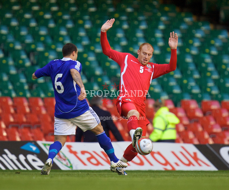 CARDIFF, WALES - Saturday, March 28, 2009: Wales' James Collins and Finland's Aleksei Ermenko during the 2010 FIFA World Cup Qualifying Group 4 match at the Millennium Stadium. (Pic by Dave Kendall/Propaganda)