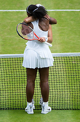 LONDON, ENGLAND - Saturday, July 9, 2016: Serena Williams (USA) embraces Angelique Kerber (GER) at the net after winning the Ladies' Singles Final 7-5, 6-3, her 22nd Grand Slam singles title, on day thirteen of the Wimbledon Lawn Tennis Championships at the All England Lawn Tennis and Croquet Club. (Pic by Kirsten Holst/Propaganda)