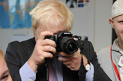 © Licensed to London News Pictures. 07/10/2014<br /> Boris Johnson meeting the students in a Photography class and having a go at being a photographer.<br /> Mayor of London Boris Johnson has officially opened the new Erith Campus for Bexley College this morning(07.10.2014) in Walnut Tree Road,Erith,Greater London.<br /> (Byline:Grant Falvey/LNP)