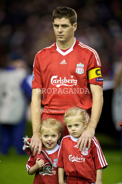 LIVERPOOL, ENGLAND - Wednesday, December 9, 2009: Liverpool's captain Steven Gerrard MBE with daughters Lily-Ella and Lexie, before the UEFA Champions League Group E match against ACF Fiorentina at Anfield. (Photo by David Rawcliffe/Propaganda)