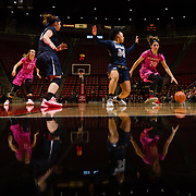 10 February 2018: The San Diego State Aztecs women's basketball team hosts Nevada on Play4Kay day at Viejas Arena. San Diego State Aztecs guard Geena Gomez (20) drives the ball into the paint against Nevada Wolf Pack guard Camariah King (24) in the second half. The Aztecs beat the Wolfpack 75-72. <br /> More game action at www.sdsuaztecphotos.com