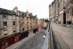 Edinburgh, Scotland, UK. 24 March, 2020.  Deserted streets in the heart of the Old Town tourist district in Edinburgh. All shops and restaurants are closed with very few people venturing outside following the Government imposed lockdown today. Pictured; View along empty Victoria Street. Iain Masterton/Alamy Live News