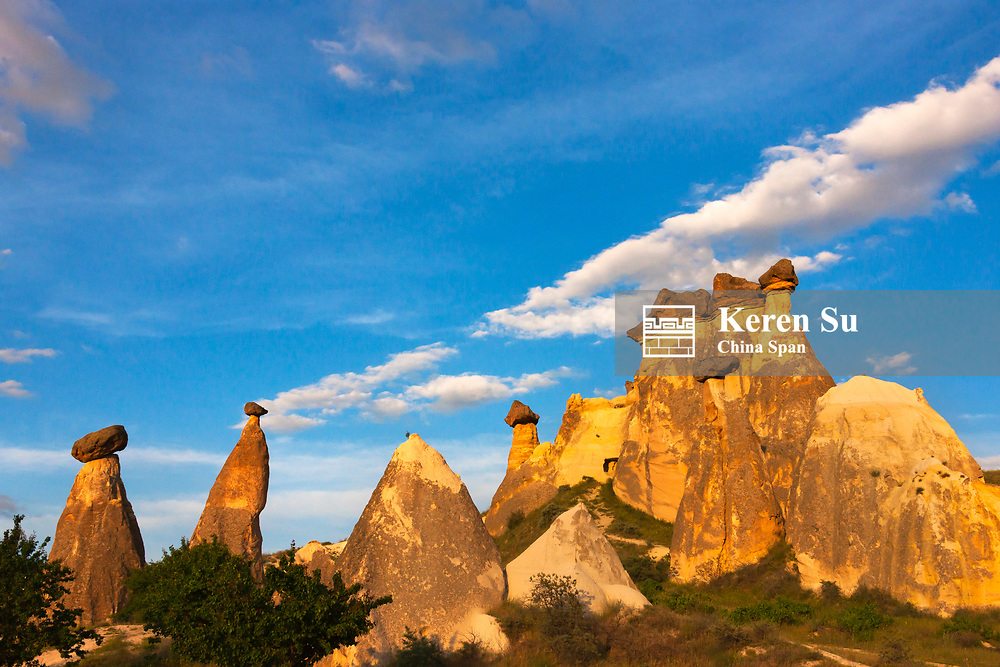 Fairy chimney rock formation in Goreme at sunset, Cappadocia, Turkey