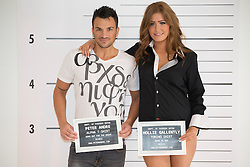 © licensed to London News Pictures. London, UK 05/11/2012. Peter Andre (left) launching his menswear collection with a model at The Worx studious in London. The fashion collection 'alpha by Peter Andre' symbolises his Greek heritage. Photo credit: Tolga Akmen/LNP