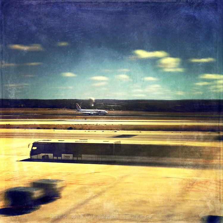 Double exposure of an arriving plane and a bus on the airport of Alicante - texturized photograph