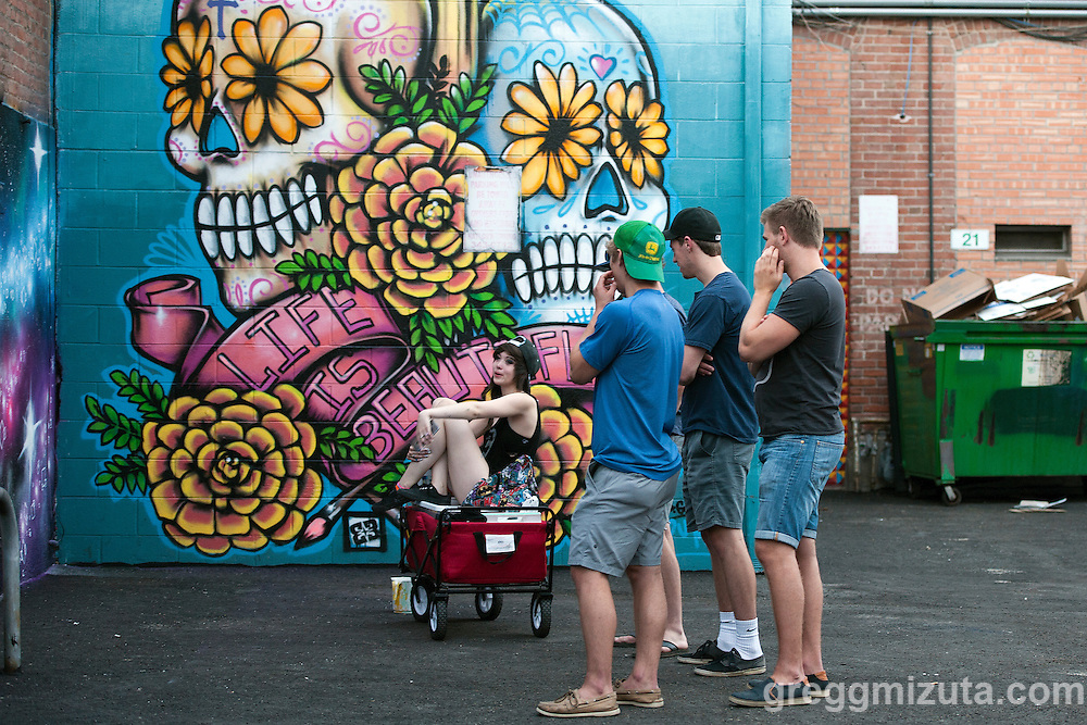 Artist Jamie Campbell at Freak Alley Gallery's sixth annual mural event in downtown Boise, Idaho on August 8, 2016. <br />