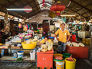 17 NOVEMBER 2016 - GEORGE TOWN, PENANG, MALAYSIA:  A vendor waits for customers in the Campbell Street Market in George Town, Penang, Malaysia. George Town is a UNESCO World Heritage city and wrestles with maintaining its traditional lifestyle and mass tourism. The market is not very busy anymore.       PHOTO BY JACK KURTZ