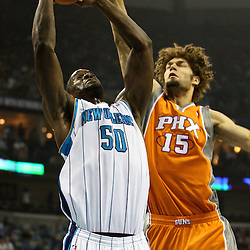 April 8, 2011; New Orleans, LA, USA; New Orleans Hornets center Emeka Okafor (50) is defended by Phoenix Suns center Robin Lopez (15) during the first quarter at the New Orleans Arena.  Mandatory Credit: Derick E. Hingle