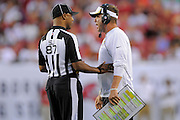 New Orleans Saints head coach Sean Payton with a referee during the Saints game against the Tampa Bay Buccaneers at Raymond James Stadium on Sept. 15, 2013 in Tampa, Florida. <br /> &copy;2013 Scott A. Miller