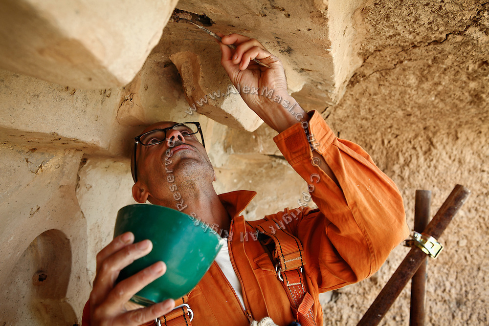 An Italian archaeologist is working on the maintenance and restoration of the Buddhas of Bamiyan's site in collaboration with a Japanese team of experts who has been visiting the town for various years to find a long-term solution to its slow but unceasing disappearance. The Buddhas of Bamiyan were two 6th century monumental statues of standing Buddhas carved into the side of a cliff in the Bamiyan valley in the Hazarajat region of central Afghanistan, situated 230 km northwest of Kabul at an altitude of 2500 meters. The statues represented the classic blended style of Gandhara art. The main bodies were hewn directly from the sandstone cliffs, but details were modelled in mud mixed with straw, coated with stucco. Amid widespread international condemnation, the smaller statues (55 and 39 meters respectively) were intentionally dynamited and destroyed in 2001 by the Taliban because they believed them to be un-Islamic idols. Once a stopping point along the Silk Road between China and the Middle East, researchers think Bamiyan was the site of monasteries housing as many as 5,000 monks during its peak as a Buddhist centre in the 6th and 7th centuries. It is now a UNESCO Heritage Site since 2003. Archaeologists from various countries across the world have been engaged in preservation, general maintenance around the site and renovation. Professor Tarzi, a notable An Afghan-born archaeologist from France, and a teacher in Strasbourg University, has been searching for a legendary 300m Sleeping Buddha statue in various sites between the original standing ones, as documented in the old account of a renowned Chinese scholar, Xuanzang, visiting the area in the 7th century. Professor Tarzi worked on projects to restore the other Bamiyan Buddhas in the late 1970s and has spent most of his career researching the existence of the missing giant Buddha in the valley.