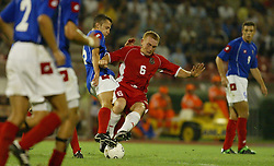 BELGRADE, SERBIA & MONTENEGRO - Wednesday, August 20, 2003: Mark Pembridge and Serbia & Montenegro's Predrag Dordevic during the UEFA European Championship qualifying match at the Red Star Stadium. (Pic by David Rawcliffe/Propaganda)