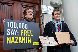 © Licensed to London News Pictures. 21/02/2018. London, UK. Richard Ratcliffe (R), husband of Nazanin Zaghari-Ratcliffe, delivers letters of solidarity for his wife to the Iranian Embassy in London, ahead of an expected visit by a senior Iranian minister. British-Iranian Nazanin Zaghari-Ratcliffe has been detained in Iran since April 2016. Photo credit: Rob Pinney/LNP