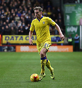 Leeds United defender Charlie Taylor dribbling during the Sky Bet Championship match between Charlton Athletic and Leeds United at The Valley, London, England on 12 December 2015. Photo by Matthew Redman.
