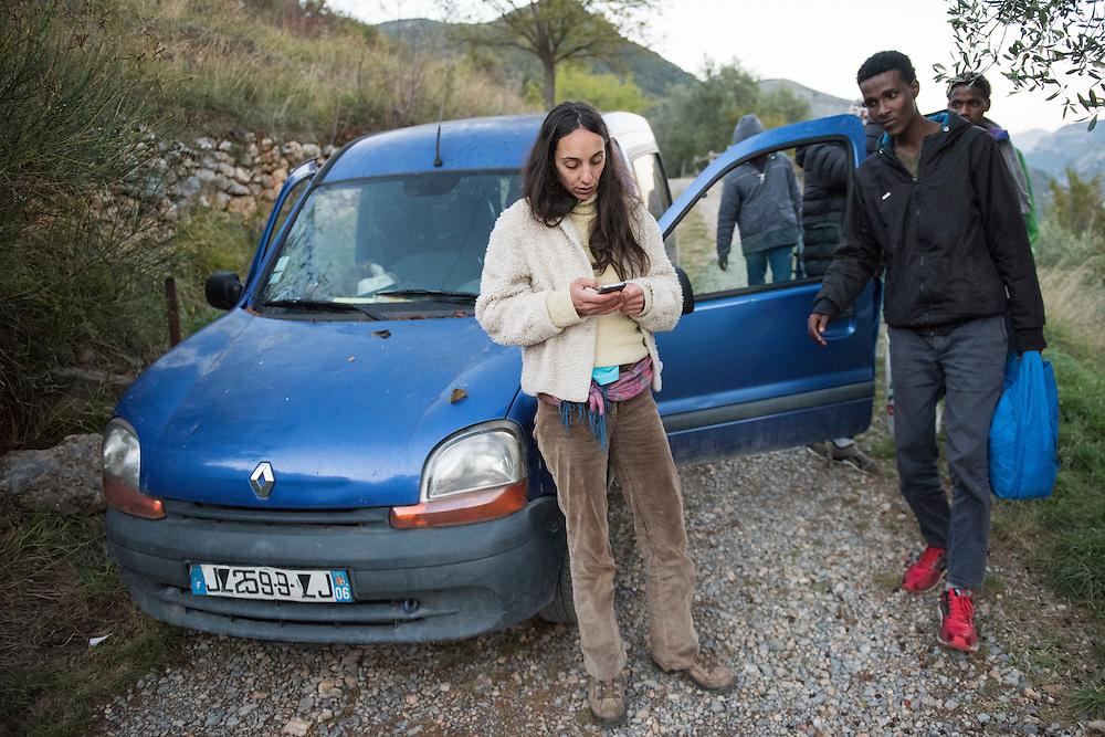 November 7, 2016 - Breil-sur-Roya, France: Eloise contacts the network of citizens who offer aid to migrants - she is one of the inhabitants of the Roya valley who help migrants. She found five Eritrean refugees walking on the road, she took them in her car, and will shelter them in her home for a night.<br /> <br /> 7 novembre 2016 - Breil-sur-Roya, France: Eloise contacte le r&eacute;seau des citoyens qui aide des migrants - elle est une des habitantes de la vall&eacute;e de la Roya qui aident des migrants. Elle a trouv&eacute; cinq r&eacute;fugi&eacute;s &eacute;rythr&eacute;ens qui marchaient sur la route, et elle les a pris dans sa voiture pour les accueillir dans sa maison pour une nuit.