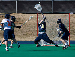 Navy Goalie Matt Coughlin (19) saves a shot by Virginia midfielder Peter Lamade (39).  The Virginia Cavaliers scrimmaged the Navy Midshipmen in lacrosse at the University Hall Turf Field  in Charlottesville, VA on February 2, 2008.