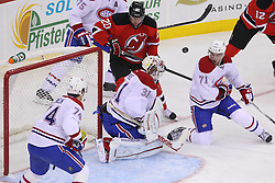 Feb 2; Newark, NJ, USA; Montreal Canadiens goalie Carey Price (31) makes a save while New Jersey Devils center Ryan Carter (20) and Montreal Canadiens center Louis Leblanc (71) battle for the rebound during the first period at the Prudential Center.