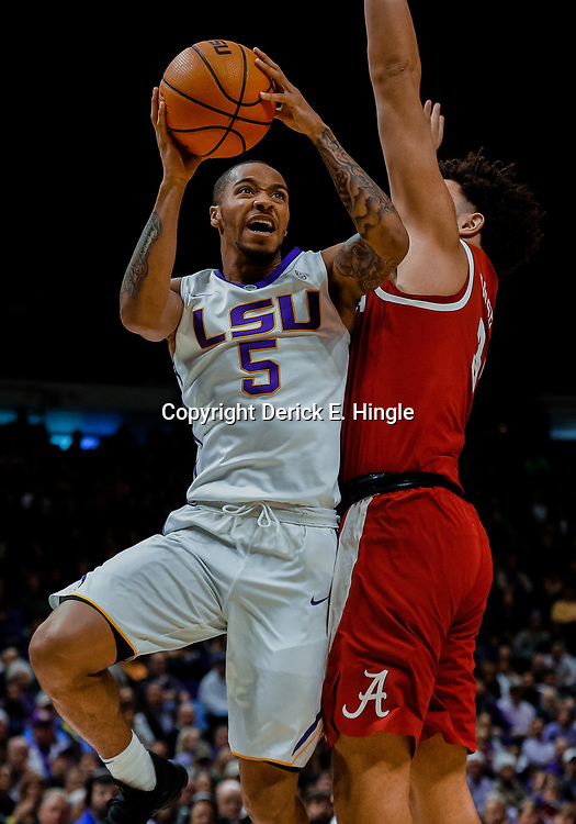 Jan 13, 2018; Baton Rouge, LA, USA; LSU Tigers guard Daryl Edwards (5) is defended by Alabama Crimson Tide forward Alex Reese (3) during the second half at the Pete Maravich Assembly Center. Alabama defeated LSU 74-66.  Mandatory Credit: Derick E. Hingle-USA TODAY Sports