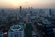 Downtown Bangkok, Chao Phraya River and South Sathorn Road at sunset seen from Banyan Tree Hotel's Vertigo Grill & Moon Bar on the 61st floor.