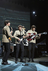 "© Licensed to London News Pictures. 17/09/2012. London, England. With John Brosnan as ""John"", Michael Gagliano as ""George"", Ian B Garcia as ""Paul"" and Phil Martin as ""Ringo"". Celebration of the 50th Anniversary of the world's most successful rock'n'roll band with a spectacular theatrical concert jam-packed with over twenty of The Beatles' greatest hits! Photo credit: Bettina Strenske/LNP"