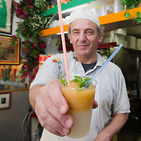 "VENICE, ITALY - JUNE 30:  Carlo Pistacchi of Gelateria Alaska in Santa Croce serves a glass of ""granita"" on June 30, 2011 in Venice, Italy. Carlo has been making ice-cream using fresh ingredients for more than 25 years and is renowned for experimenting with new flavours, offering his customers classic favourites such as rum and raisin or chocolate as well as some of his more unconventional creations such as asparagus or rocket salad and orange."