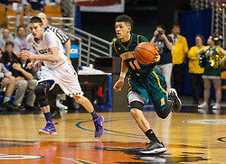 Huntington guard Tavian Dunn-Martin (11) dribbles the ball up the floor against Parkersburg South during the Class AAA championship game at the Charleston Civic Center.