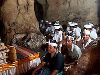 Balinese pilgrims praying inside the cave temple complex at Goa Giri Putri on Nusa Penida, Bali, Indonesia