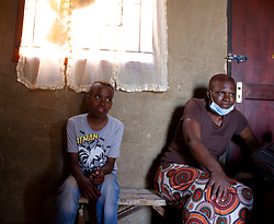"""May 9, 2020, Johannesburg, Gauteng, South Africa: HIV and tuberculosis just became a less curable ill in the vast township of Alexandra, South Africa. Phumlani's fight against the two deadly diseases is hardened by starvation on 09th May 2020, while his sister Thokozo is forced to walk a few miles with a newborn baby to get him medications from the clinic. """"I no longer have transport money, and taxis only operate in the morning these days. I am afraid of nyaope   (deadly drug) addicts, who steal ARVs to make their drugs. (Credit Image: © Manash Das/ZUMA Wire)"""