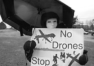 HORSHAM, PA - MARCH 29:  Karen Barton, along with members of Coalition for Peace Action protest the Horsham Drone Command Center to protest March 29, 2014 in Horsham, Pennsylvania. The mask represents civilians that have been killed by drone strikes. (Photo by William Thomas Cain/Cain Images)