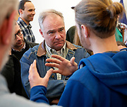 Sen. Tim Kaine listens to Trevor Piersol when he spent over a half an hour wading into the packed crowd to speak one-on-one with individuals during his town hall meeting at the Staunton Library as he begins his 2018 campaign for his senate seat in November on January 7, 2018. (Randall K. Wolf/For The News Virginian) Trevor Piersol