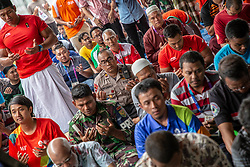 August 24, 2018 - Palembang, South Sumatera, Indonesia - Palembang, South Sumater, Indonesia, 24 August 2018 : Friday pray held during the bussy Asian Games 2018 event at Jakabaring Stadium-Palembang-South Sumatera. All muslim partificipant athlete, official, and millitary security joining in the friday pray held at the mosque inside the stadium. (Credit Image: © Donal Husni/ZUMA Wire)