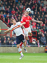 WREXHAM, WALES - Monday, May 7, 2012: Wrexham's Mark Creighton in action against Luton Town's Janos Kovacs during the Football Conference Premier Division Promotion Play-Off 2nd Leg at the Racecourse Ground. (Pic by David Rawcliffe/Propaganda)