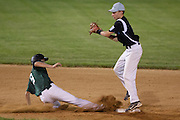 West Deptford's Chris Dillaquilla slides back into second as Pennsylvania's Mike Carey tries to tag him out during the opening round of the Mid-Atlantic Senior League regional tournament held in West Deptford on Friday, August 5.