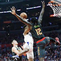 08 January 2018: LA Clippers guard Tyrone Wallace (12) is fouled  by Atlanta Hawks forward Taurean Prince (12) during the LA Clippers 108-107 victory over the Atlanta Hawks, at the Staples Center, Los Angeles, California, USA.