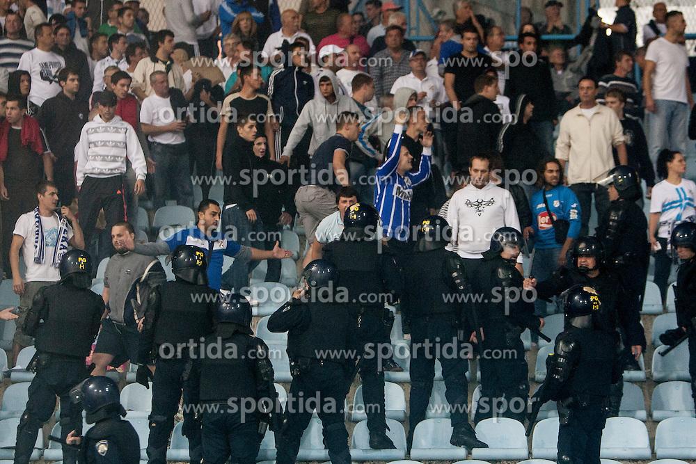 Fans of HNK Rijeka fightin with police during football match between HNK Rijeka and HNK Hajduk Split in 11th Round of Prva Hrvaska Nogometna Liga MaxTV 2013/14 on September 28, 2013 in Stadion Kantrida, Rijeka, Croatia. (Photo By Urban Urbanc / Sportida.com)