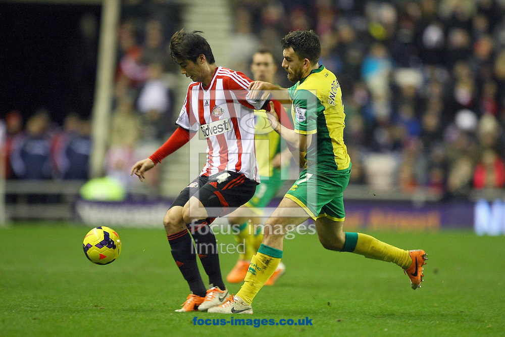 Picture by Paul Chesterton/Focus Images Ltd +44 7904 640267<br /> 21/12/2013<br /> Sunderland's Ki Sung-Yueng and Robert Snodgrass of Norwich in action during the Barclays Premier League match at the Stadium Of Light, Sunderland.