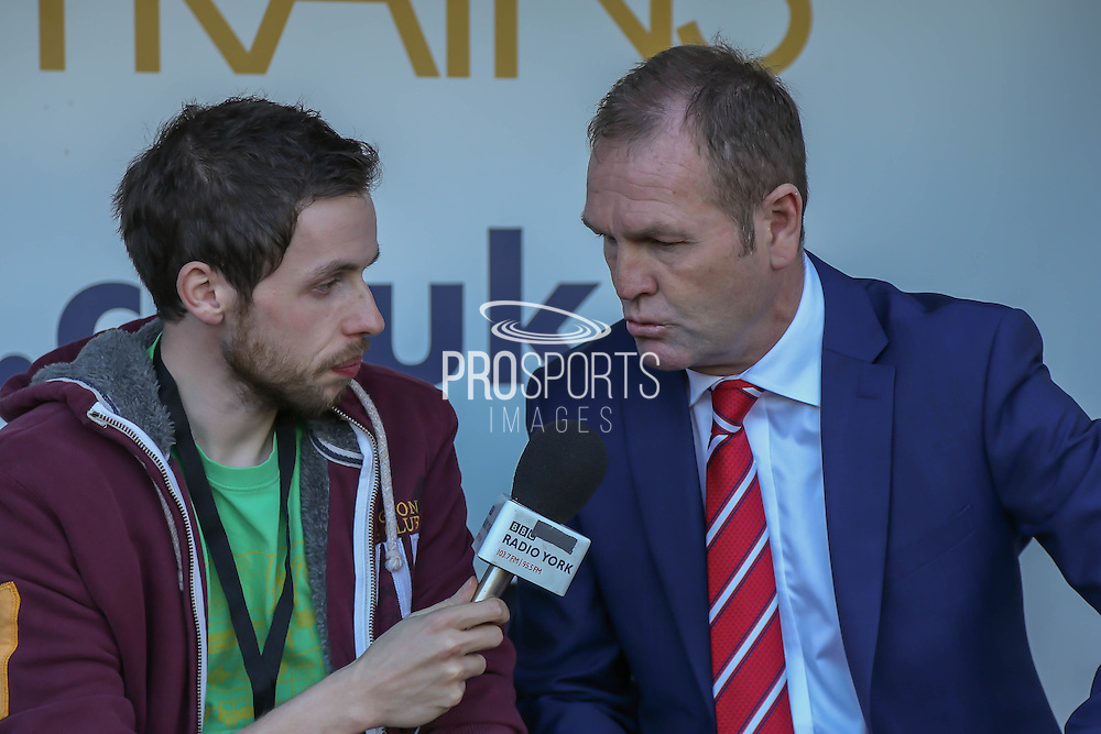 York City Manager Russell Wilcox interviewed by BBC York prior to the Sky Bet League 2 match between Notts County and York City at Meadow Lane, Nottingham, England on 26 September 2015. Photo by Simon Davies.