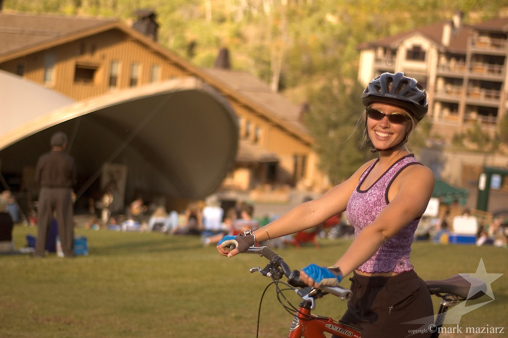 Carrie riding at Deer Valley Resort, Utah, with concert in background