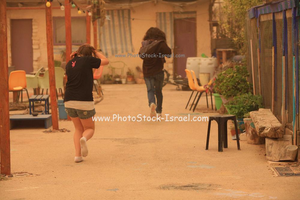 Israel, Negev, Mitzpe Ramon, A desert sand storm People run for shelter