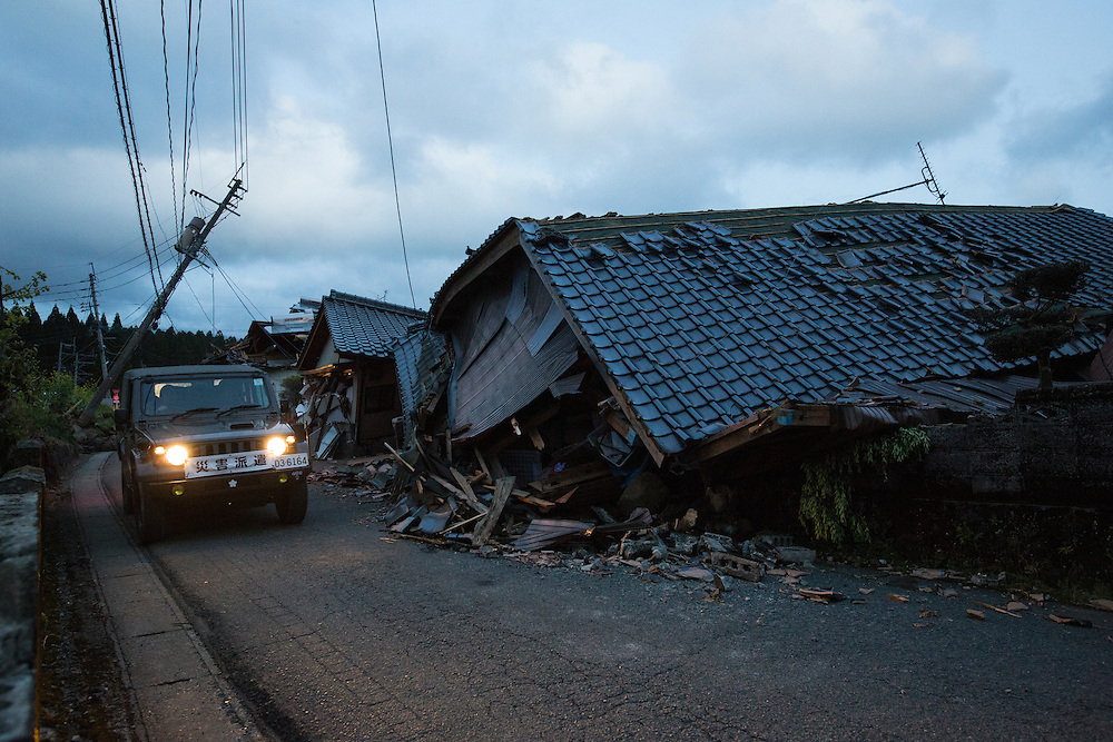 KUMAMOTO, JAPAN - APRIL 17: Japan Self-Defense Forces (SDF) car passing in front of a broken house in Minami Aso on April 17, 2016 Sunday Afternoon. Saturday&rsquo;s magnitude-7.3 quake struck at 01:25 (15:25 GMT on Friday) close to the city of Kumamoto, which had been hit by a magnitude-6.4 quake on Thursday night.<br /> Photo: Richard Atrero de Guzman