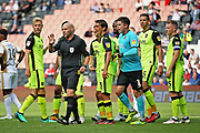 Referee Charles Breakspear struggles to keep control after the second penalty during the EFL Sky Bet League 2 match between Milton Keynes Dons and Exeter City at stadium:mk, Milton Keynes, England on 25 August 2018.