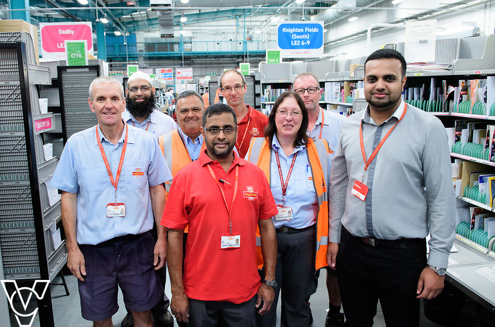 Two delivery offices, Oadby and Leicester South, which are both based inside the Leicester Mail Processing Unit building, have passed the penultimate gateway of One Plan.  One Plan is a business programme designed to have a standardised operation of excellence.  Pictured is, from left, David Sentance, Mohammed Issat, Arvind Mistry, Sayed Kadiri, Jeremy Coulson, Pearl Howard, Richard Ashdown and Shahbaaz Khan.<br /> <br /> Picture: Chris Vaughan Photography<br /> Date: July 7, 2017