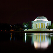 The Jefferson Memorial at night, reflecting off the calm waters of the Potomac River tidal basin.